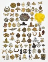A collection of cap badges with various regiments including The Buffs, Royal Artillery, Labour