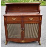 A reproduction mahogany music centre in the form of a chiffonier with brass gallery back, above a