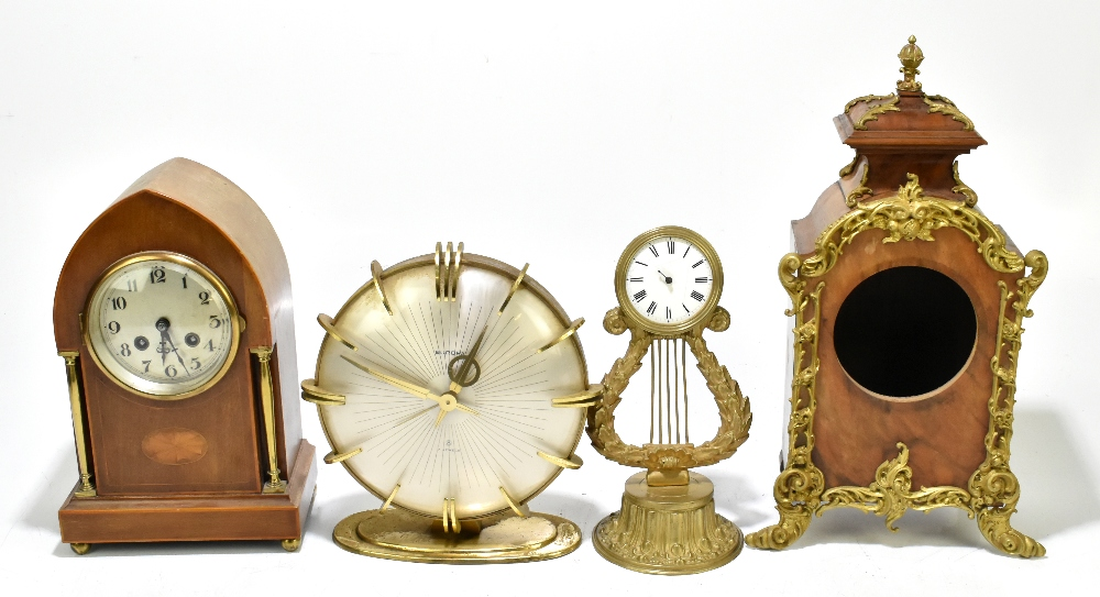 An Edwardian inlaid mahogany lancet topped mantel clock, the silvered dial with Arabic numerals,