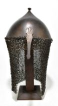 A 16th century and later Mamluk-type helmet of typical form with nasal guard and suspended