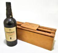 PORT; a single bottle of Sandeman vintage 1975 (bottled 1977), housed in Jaguar branded wooden