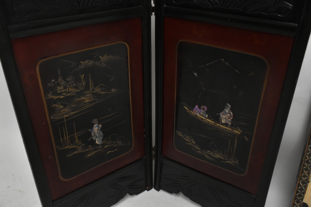 An early 20th century Chinese lacquered two division folding screen, the rectangular panels inlaid - Image 3 of 3