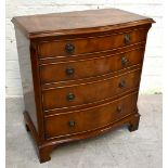 A reproduction mahogany serpentine chest with moulded top over four graduated long drawers, on