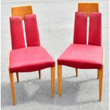 A set of four mid-century elm and beech framed dining chairs of unusual form, with open backs,
