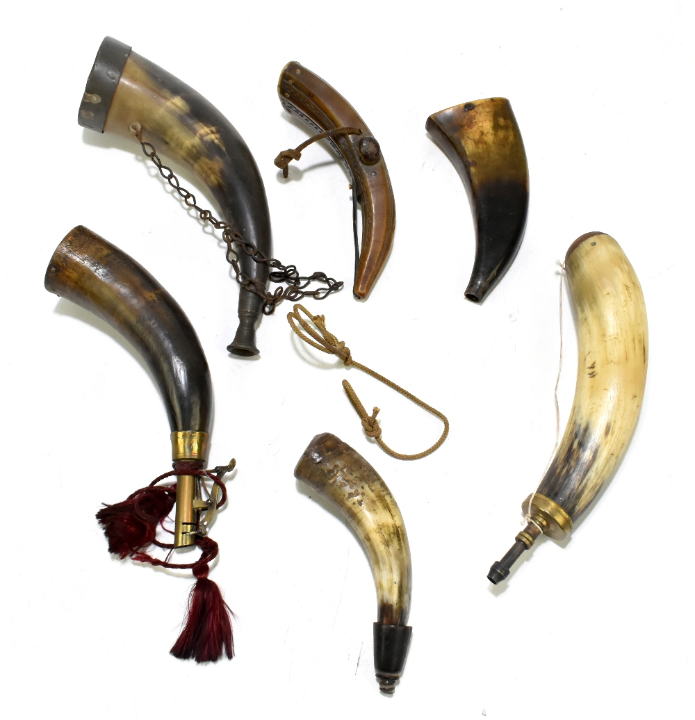 Six 19th century horn powder flasks, the largest length approx 26cm, one with carved detail, one