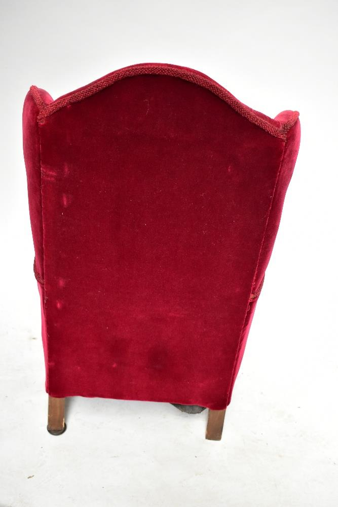 An early 20th century wingback armchair, upholstered in a red material, raised on ball and claw - Image 4 of 4