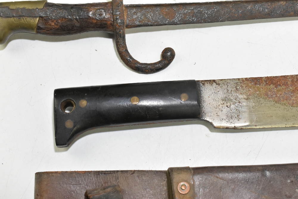 A machete, blade length 37cm, in leather scabbard, a bayonet (heavily worn) and a further blade (3). - Image 2 of 4