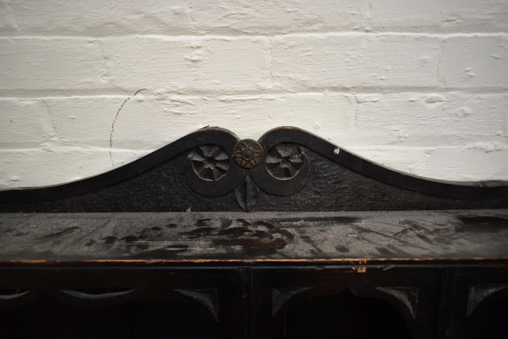 A 19th century carved oak wall cupboard, with an arrangement of seven sections with carved side - Image 5 of 5