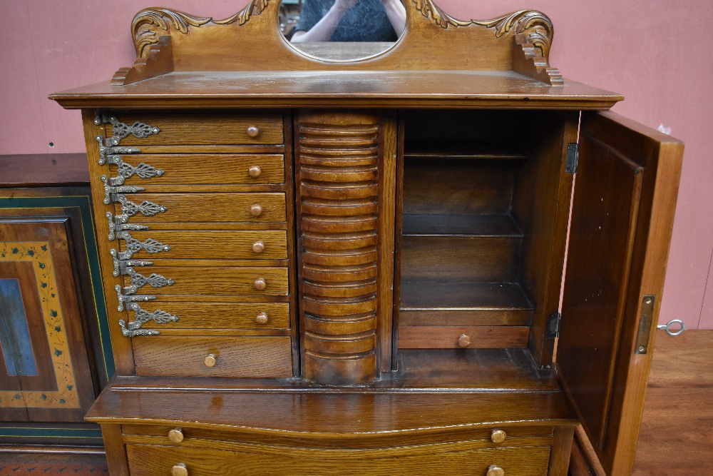 A modern Egyptian oak jewellery cabinet, with a mirrored cupboard door and seven small drawers - Image 2 of 4