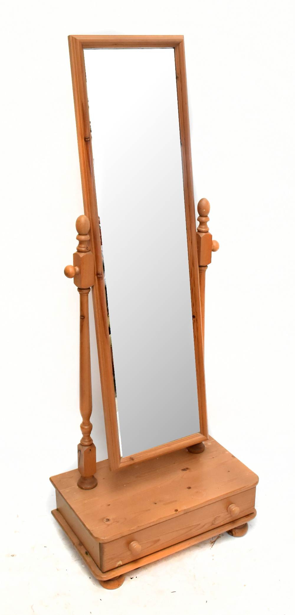 A modern pine cheval mirror with rectangular plate on a box base with a single drawer, height