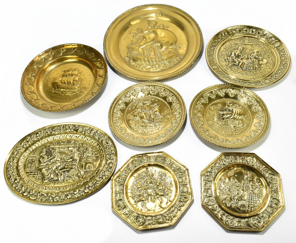 A collection of thirteen early 20th century embossed brass wall plates and chargers, probably Dutch, - Image 2 of 2