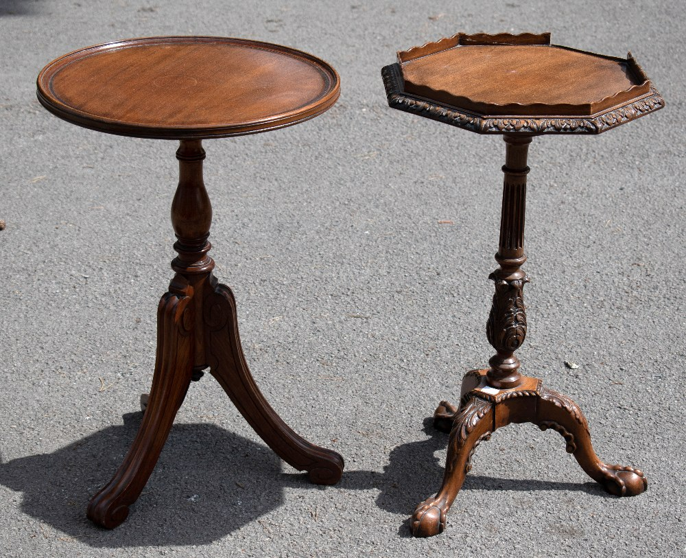 A reproduction mahogany circular tripod table, with turned column, on carved tripod base, height