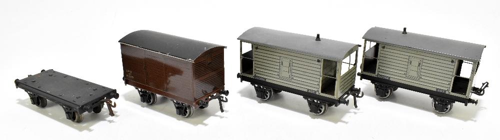 BASSETT-LOWKE; two brake vans, a closed van and a possibly Bassett-Lowke flatbed truck (4).