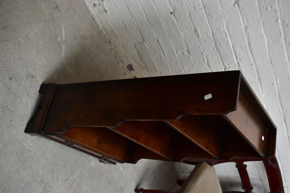 A reproduction oak waterfall bookcase with four open shelves above a base drawer, on bracket feet, - Image 2 of 4