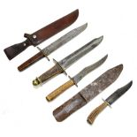 Four knives/daggers, the largest a sawback example with stamped marks to blade base, the brass guard