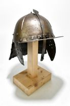 A zischägge or lobster tailed helmet in the 17th century style, the skull with raised ribs,