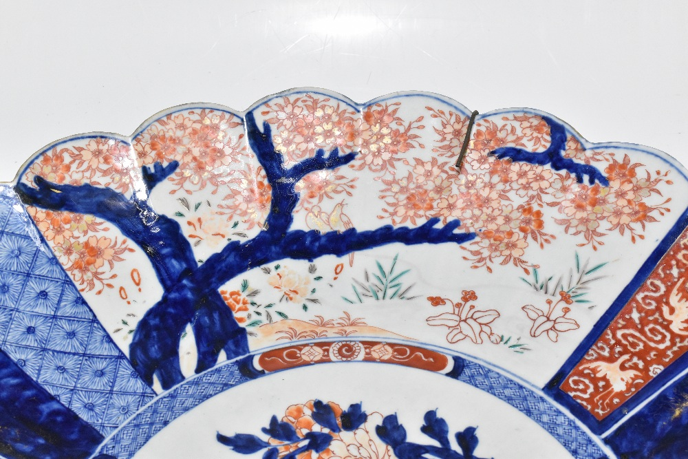 A large late 19th century Japanese Imari charger, of circular form with panelled detail depicting - Image 4 of 5