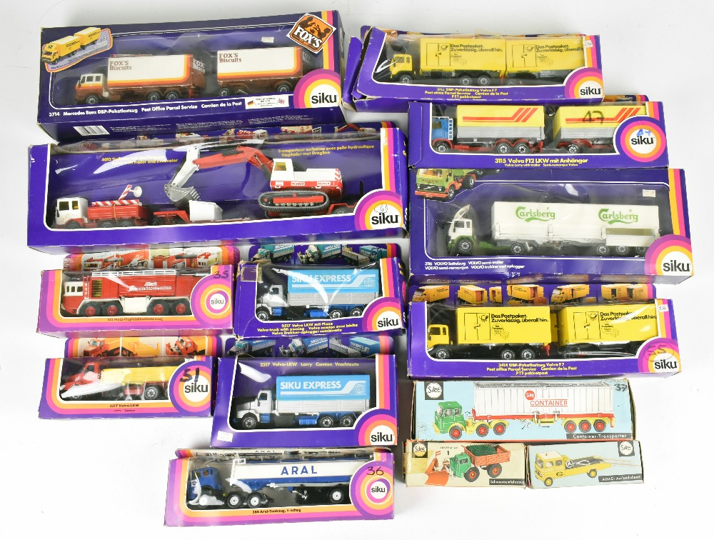 SIKU; fourteen boxed models including 3714 DBP-Paketlastzug Volvo F7, 3115 Volvo F12 LKW, 288 Aral-