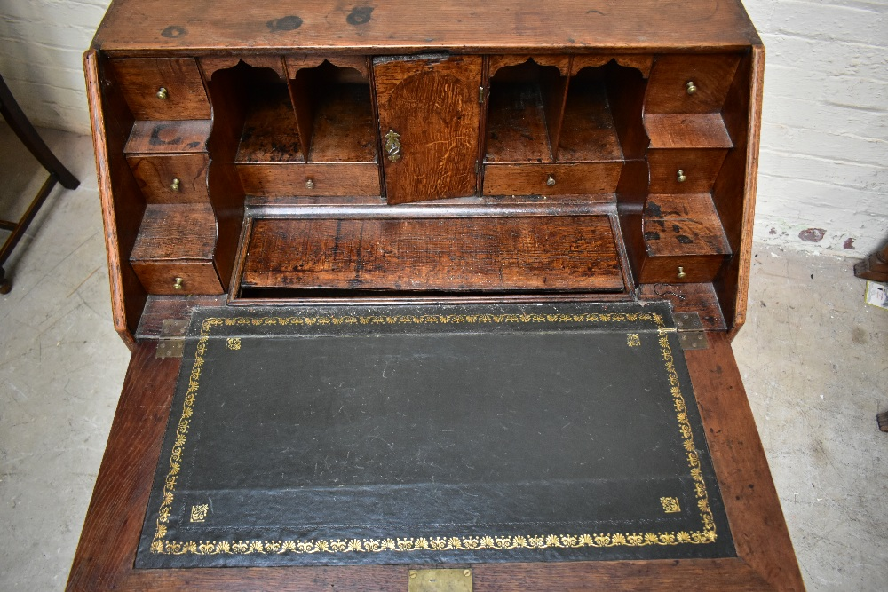 A George III oak bureau withfall-front enclosing a fitted interior with eight drawers and four - Image 5 of 6