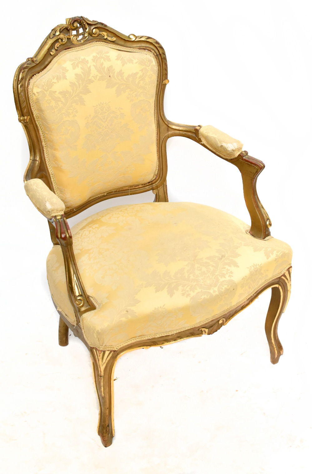 An early 20th century French fauteuil with gilt heightened frame, padded back, arms and seat and