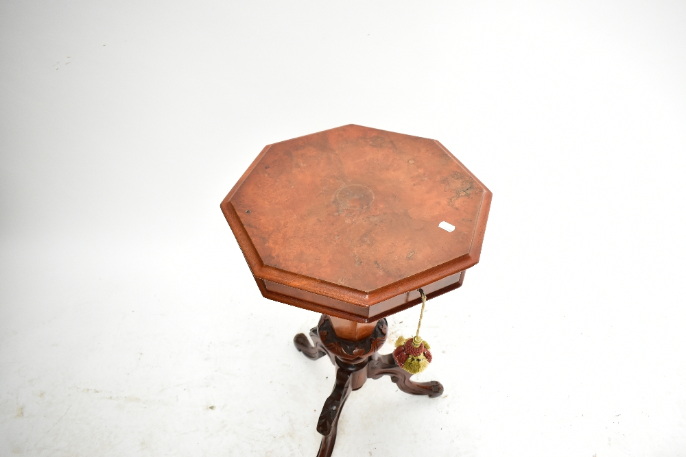 A Victorian walnut octagonal sewing table with fitted interior on three knee carved outswept - Image 2 of 4