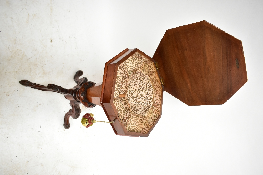 A Victorian walnut octagonal sewing table with fitted interior on three knee carved outswept - Image 3 of 4