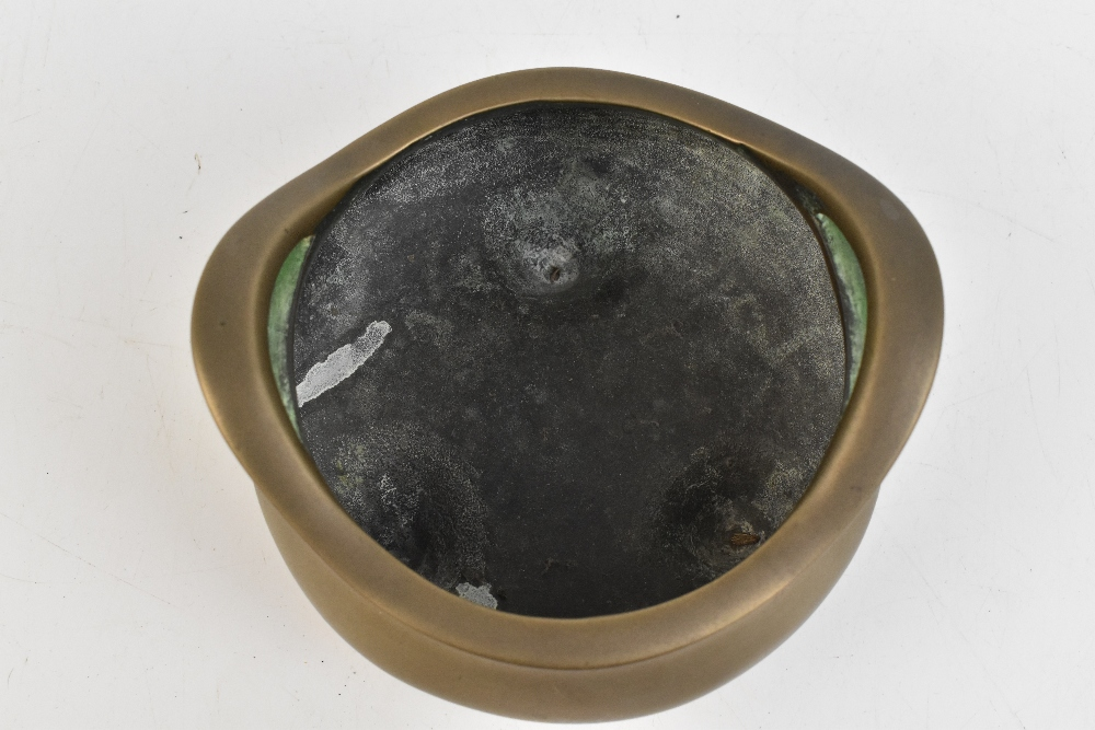 A Chinese bronze censer with raised pierced handles, three simple tapering supports and impressed - Image 5 of 7