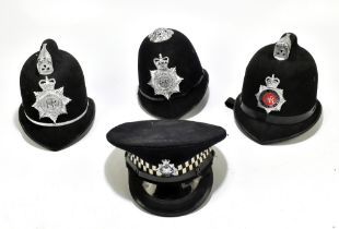 Three Police helmets with Staybrite badges and mounts, the first for Greater Manchester Police by