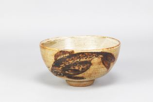 HENRY HAMMOND (1914-1989); a stoneware footed bowl with iron fish and floral decoration and circular