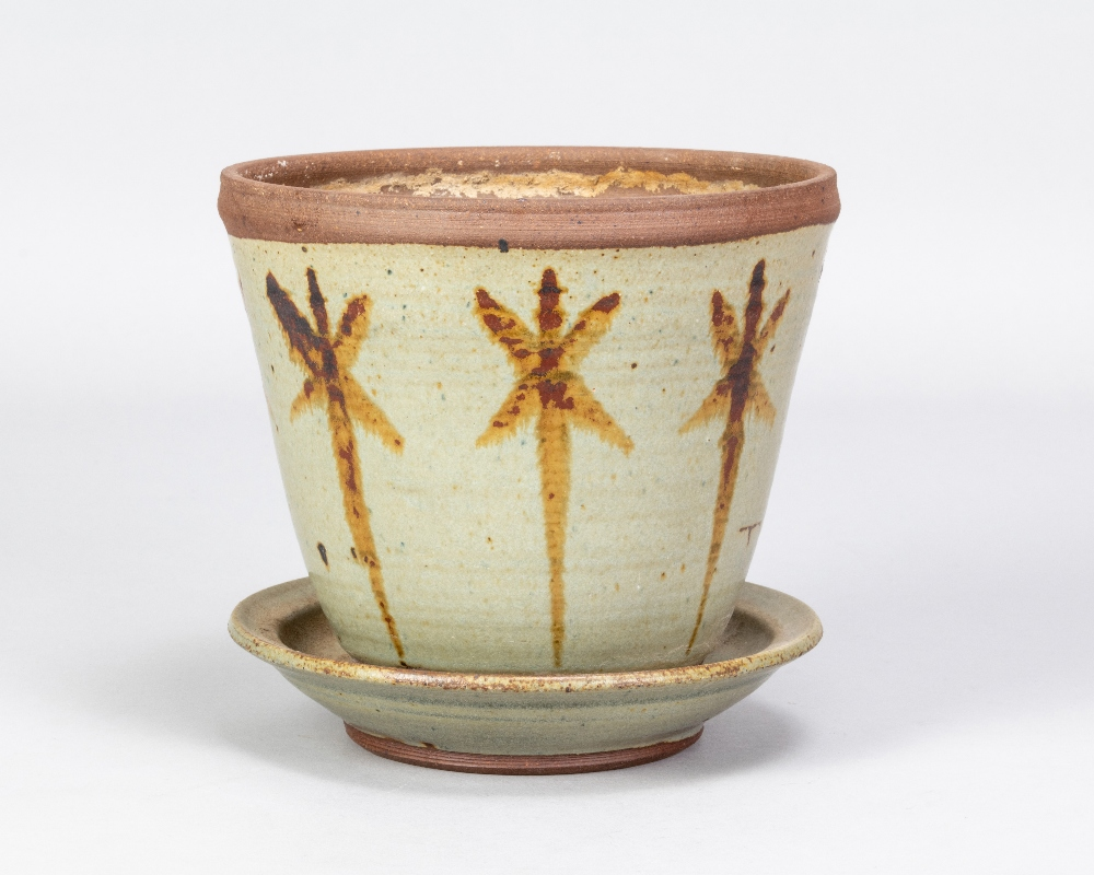 VERA TOLLOW (born 1931); a stoneware flower pot and saucer with iron decoration on green/grey