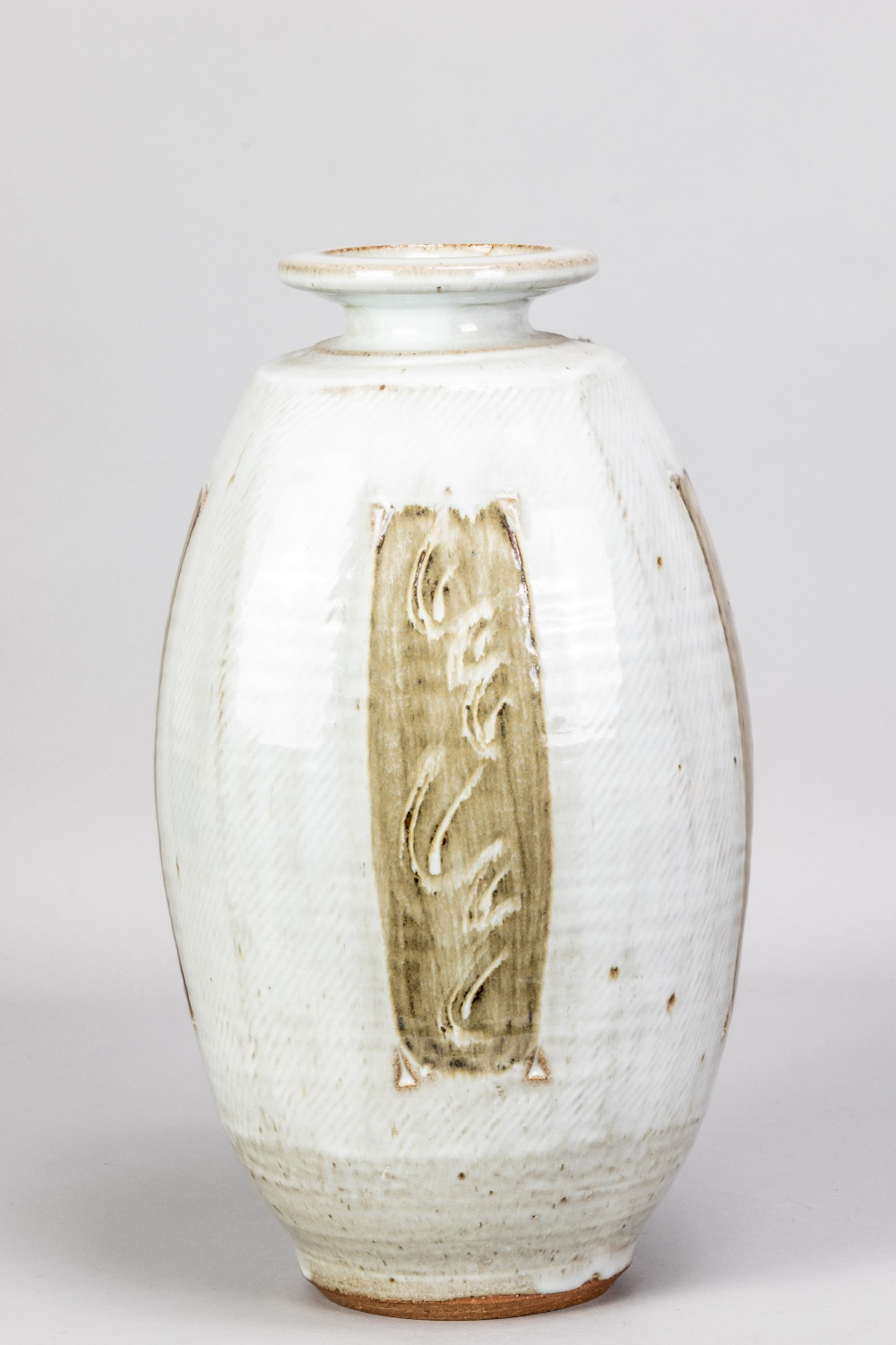 WILLIAM PLUMPTRE (born 1959); a tall stoneware bottle covered in braided white glaze decorated
