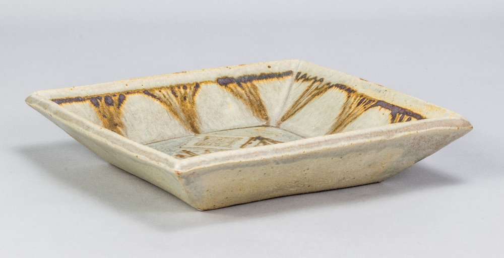 VERA TOLLOW (born 1931); a square stoneware dish covered in green/grey glaze with iron decoration,