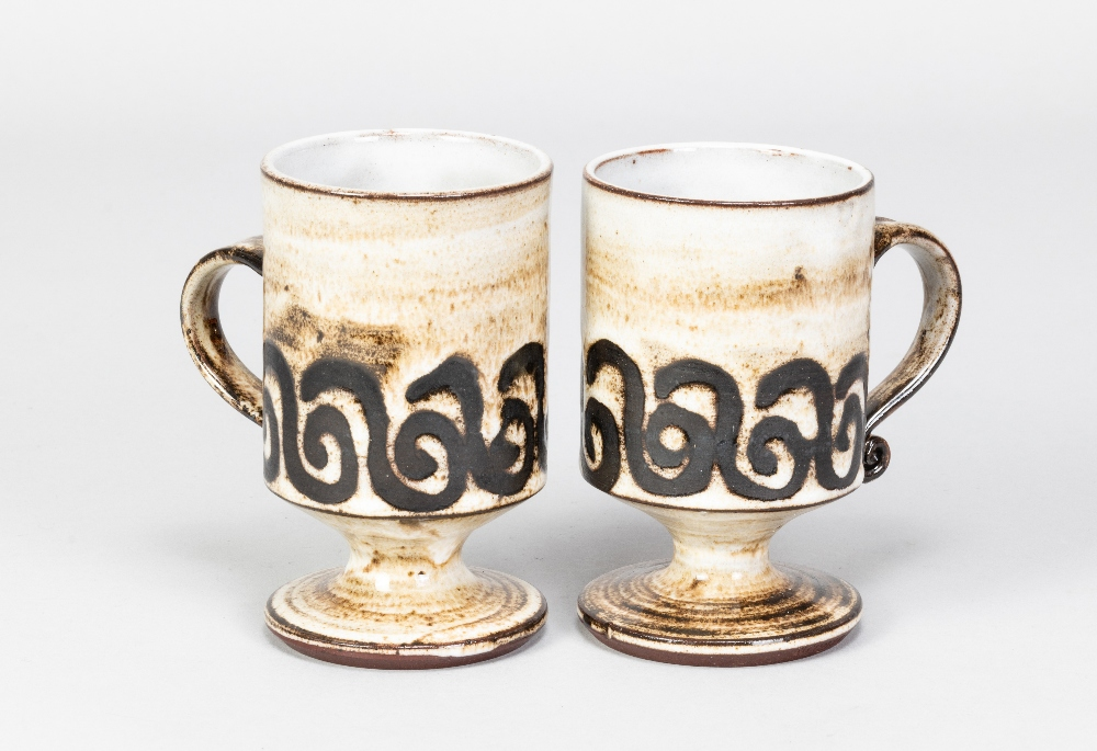Briglin Pottery; four pairs of tin glazed earthenware footed mugs with four different decorations, - Image 3 of 6