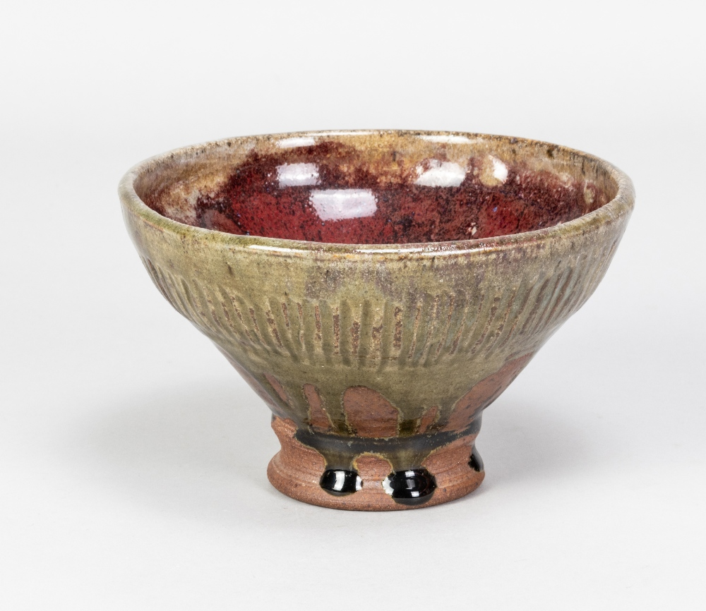 DENIS MOORE (1908-1977) for Green Dene Pottery; a fluted stoneware footed bowl covered in copper red