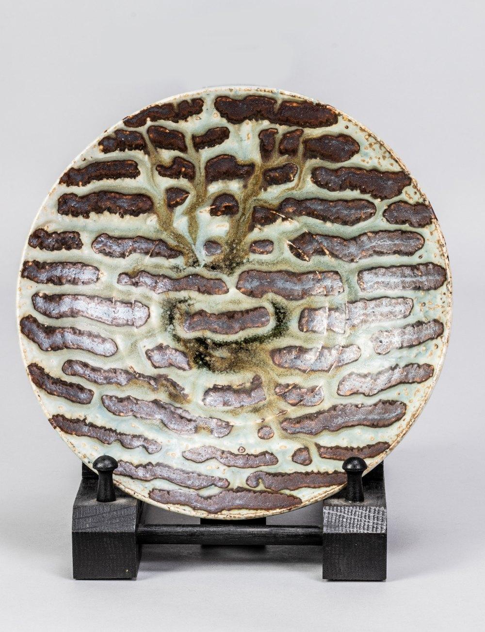 DEREK DAVIS (1926-2008); a porcelain dish covered in running green glaze on iron rich ground, - Image 3 of 5