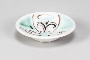 SYBIL FINNEMORE for Yellowsands Pottery; a small stoneware dish with painted floral decoration,