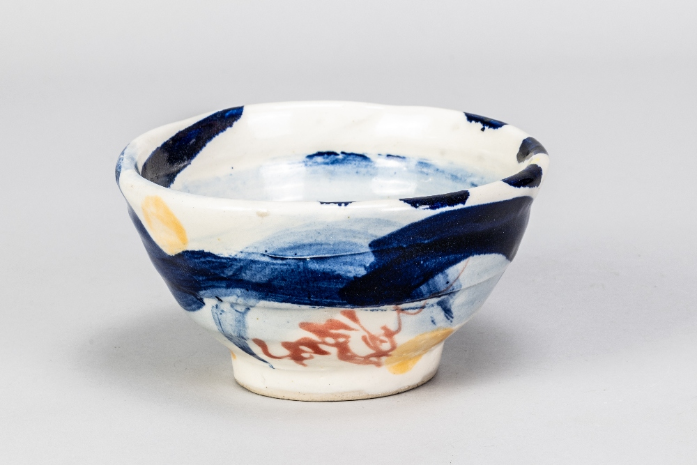 SANDY BROWN (born 1946); a stoneware footed bowl with blue and orange decoration on white ground,