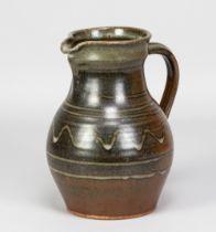 PAUL BARRON (1917-1983); a stoneware jug with wax resist decoration on iron rich ground, impressed B