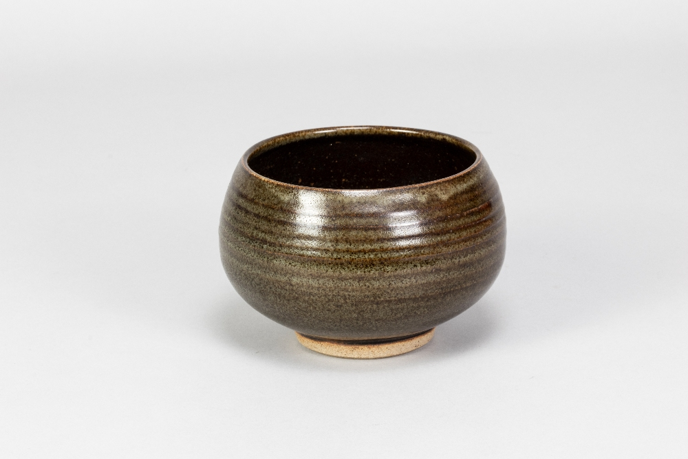 PAUL BARRON (1917-1983); a stoneware chawan covered in tenmoku and mottled green glaze, impressed