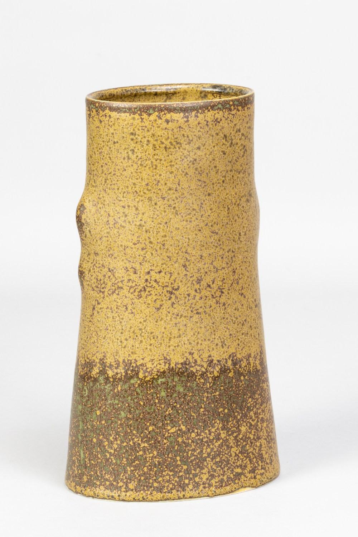 EILEEN LEWENSTEIN (1925-2005); an oval tapered porcelain vase covered in mottled ochre glaze,