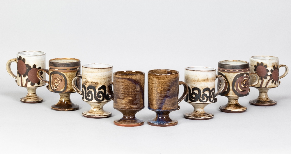 Briglin Pottery; four pairs of tin glazed earthenware footed mugs with four different decorations,