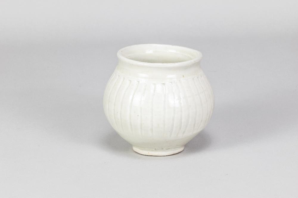 BERNARD LEACH (1887-1979) for Leach Pottery; a fluted porcelain pot covered in celadon glaze,