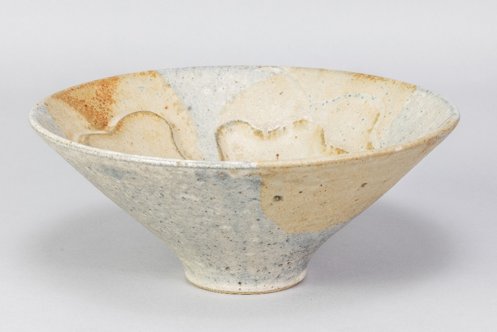GILLIAN LOWNDES (1936-2010); a conical stoneware bowl covered in mottled blue/grey and oatmeal