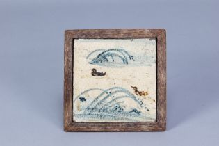 BERNARD LEACH (1887-1979) for Leach Pottery; a stoneware tile depicting ducks and reeds in