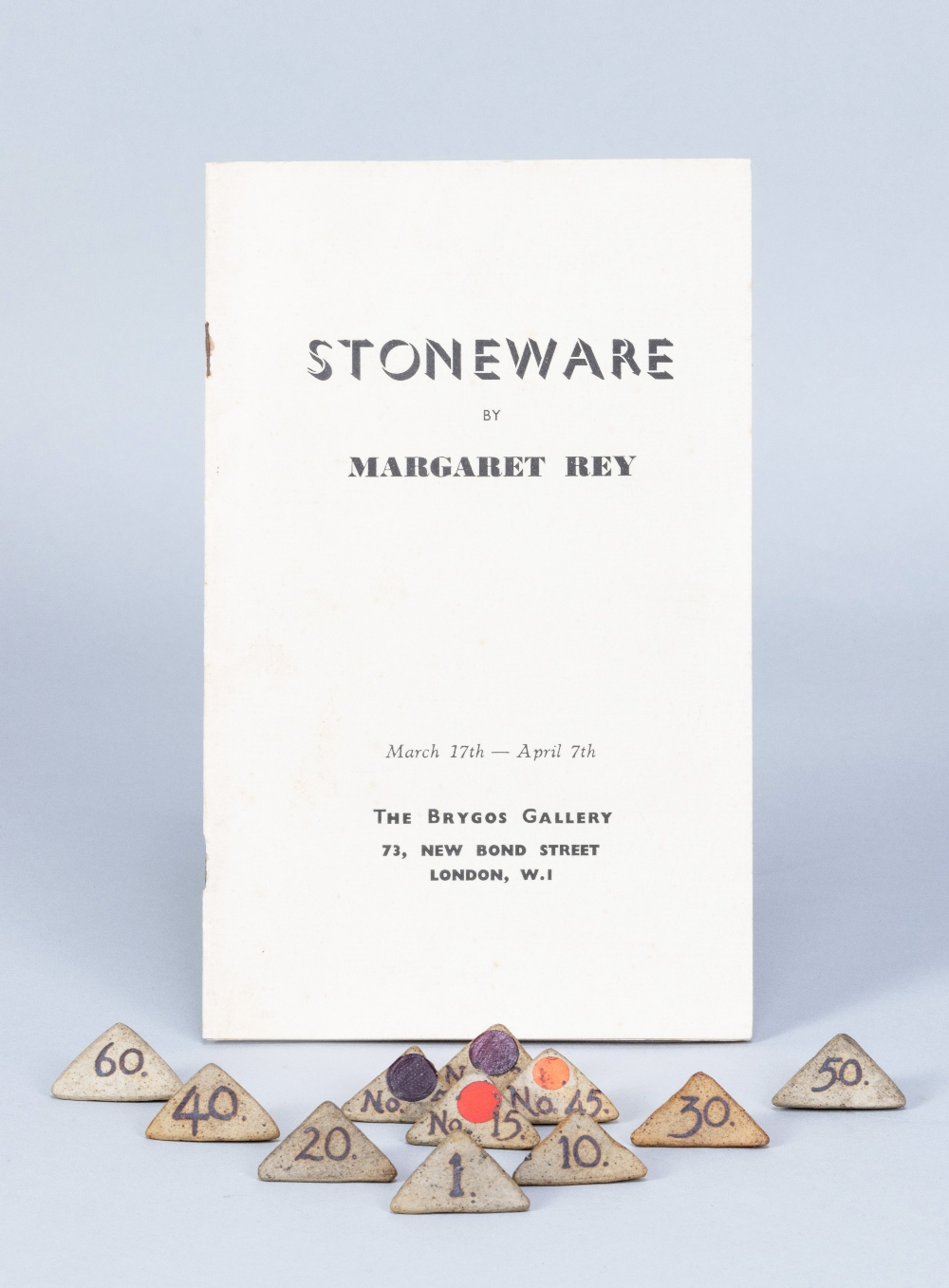 MARGARET REY (1911-2010); a set of triangular stoneware exhibitionnumbers, made 1938, and an