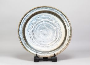 PAUL BARRON (1917-1983); a stoneware charger with wax resist decoration on washed cobalt ground,
