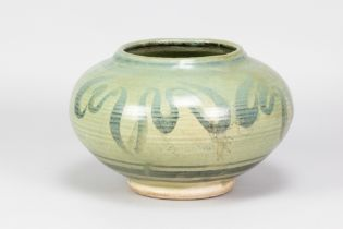 PERCY BROWN (1911-1996); a large squat stoneware vase with cobalt decoration on green ground,