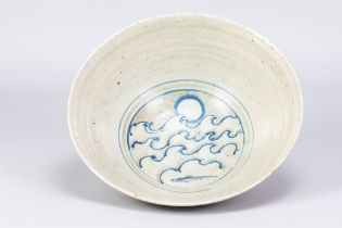 HENRY HAMMOND (1914-1989); a large stoneware footed bowl with cobalt wave decoration to well,