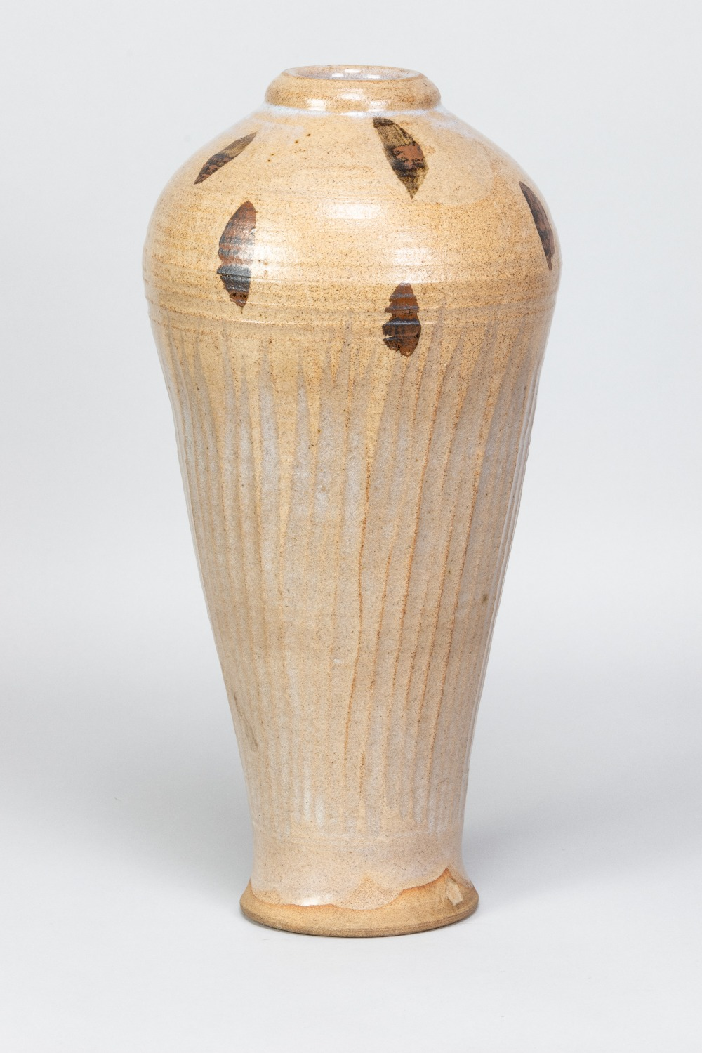 WILLIAM STAITE MURRAY (1881-1962); a tall stoneware bottle with fluted body and iron decoration to
