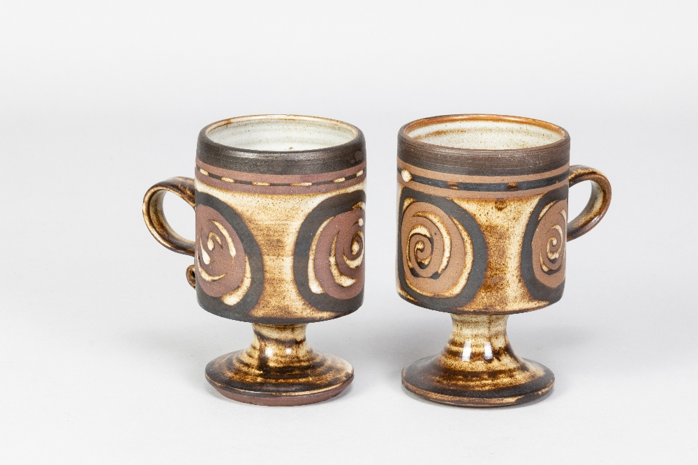 Briglin Pottery; four pairs of tin glazed earthenware footed mugs with four different decorations, - Image 4 of 6